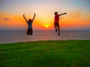 two-people-leaping-in-joy